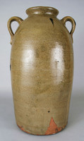 Five-gallon jug with strap-handle on either side of shoulder