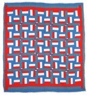 Flag quilt with stripes of red, white, and blue.