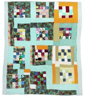 Sixteen patch pattern quilt with blocks.