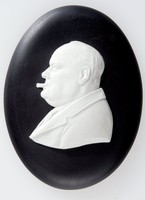 """Oval black jasper medallion with white relief profile portrait of Winston Churchill smoking a cigar (1874-1965) facing left. Winston Churchill was a British politician who was Prime Minister between 1940 and 1945 and again between 1951 to 1955. As Prime Minister, Churchill led Britain to Victory against Nazi Germany. He is well known for his famous speech """"Never in the field of human conflict was so much owed by so many to so few"""""""
