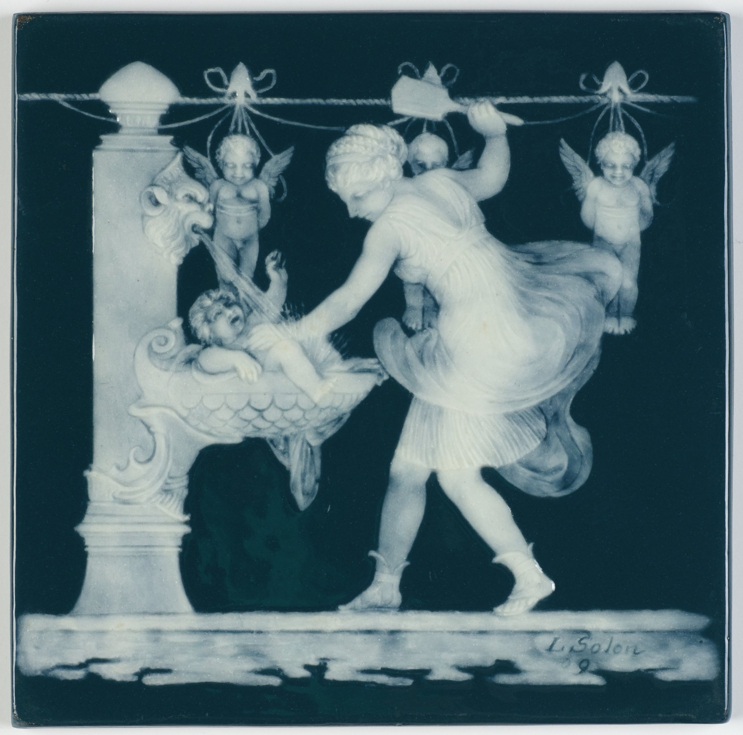 A Parian plaque, or tile, with a dark blue-green, glazed ground with white pâte-sur-pâte decoration depicting a nymph wearing a diaphanous robe, holding a protesting cherub in the scale-patterned basin of a columnar fountain with her left hand and wielding a scrubbing brush in her raised right hand, behind her are three additional cherubs suspended from a line on which they have been hung out to dry.