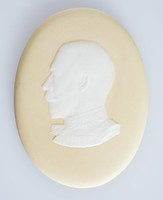 Oval yellow jasper medallion with white relief profile portrait of King George V. (1865-1936), was King of the United Kingdom and the British Dominions, and Emperor of India, from 6 May 1910 until his death in 1936.
