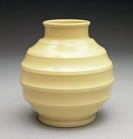 Small bulbous vase in Keith Murray shape number 3765 of creamware covered with a matt yellow, or straw, glaze, with foot and a series of molded rings around the body, the neck slightly extended.