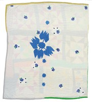 Blue appliqued flowers on white, over another star patterned quilt.