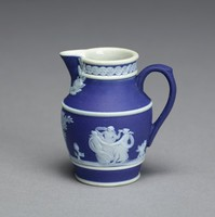 Miniature jug of white jasperware with dark blue jasper dip and white relief decoration, with loop handle and decorative band around the neck, on the body the relief scenes of Coriolanus with his wife and mother who entreat him to return to Rome and the Three Graces.