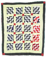"""Endless stairs quilt. Light colored fabric on lower left has printed, """" Enterprise AL"""""""