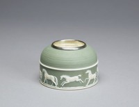 Green jasperware match holder and striker with relief frieze and stubbs horses in different poses around base. the horses modelled by Edward Burch after George Stubbs