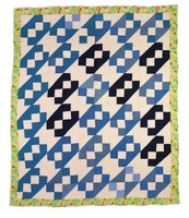 Rocky Road to Georgia quilt, blue and black on white with floral binding.