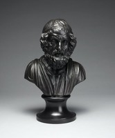 Portrait bust in black basalt of the Greek poet Homer dressed in classical robes and cap on round socle.