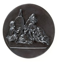 Round basalt plaque with Reynold's Infant Academy. Which shows a young boy painting on an oval canvas a young girl with a fashionable hat, who is flanked by two other children.