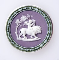 Round tri-color jasper (green, lilac, and white) medallion with white relief depicting the Power of Love. polished on edge broken and repaired.