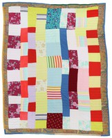 Red, yellow, blue, and floral strip quilt.