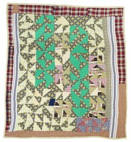 Triangles quilt with green and plaids.