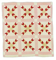 Chevron or fishtail quilt, red and cream with pink borders