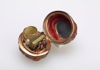 Small sewing etui comprised of an actual walnut (covered with a varnish to preserve it) with gold and gilt brass mounts and hinged so that it can be opened and closed, the interior on one side set with a small round mirror and red velvet lining, on the other with a gilt brass mount outfitted with small, delicate sewing instruments including an ivory thimble with gold mount, a stiletto, scissors, an ivory needle case, a miniature leather-lined book, a file, needles and a pin.