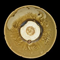 """Bowl with notched rim and molded design of three human figures alternating with three of the eight Buddhist precious objects, the characters """"guanyao"""" (official ware) at center."""