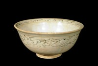 Bowl decorated with chrysanthemum spray in well and scrolling bands below exterior rim, all painted in blue-brown cobalt-oxide with enclosing lines in brown iron-oxide.