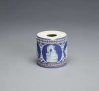 Small hollow drum made of white jasper with dark blue and lilac jasper dip (tricolor) and white relief decoration, round with a hole at either end, the body with a border of oak leaves against a lilac ground at the bottom and a border of intersecting circles against a lilac ground at the top, in the middle a series of four reserves within which are small relief scenes including, Cupid as Oracle; Coriolanus (Coriolanus with his wife and mother who entreat him to return to Rome); Endymion on Latmos; and Hebe giving sustenance to the eagle, between small dividers comprised of acanthus leaves and anthemion motifs.