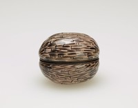 Small enameled copper bonbonnière in the form of a walnut, with metal mounts.