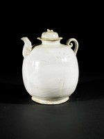 Ewer with lobed body, domed cover with vegetal sprig handle, molded spout, spiral handle, floral sprays painted in underglaze-iron.