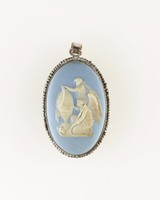Oval blue jasper cameo with white relief of two figures, set in steel with ring as a pendant