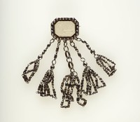 Octagonal white jasper cameo with relief scene, set in cut steel as a brooch with steel bead dangles