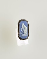 Octagonal blue jasper cameo with white relief of woman (Hope?) with anchor, set in silver as a screwback earring, cracked