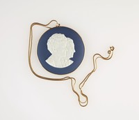 Round dark Portland blue jasper medallion with white relief profile portraits of Harry and Nettie Buten, set in gold as pendant with gold chain necklace