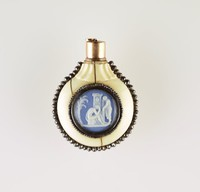 Ivory perfume bottle with cut steel decoration and mounts, with two round blue jasper cameos with white relief scenes, one set on each side, with gold cap and crystal stopper