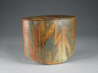 Large, oblong, or boat-shaped, vessel of glazed stoneware, the bottom rounded slightly upward at the sides, with flat cover, the vessel is decorated in shades of gray, rust, and gold-beige with flecks of brown in an organic pattern that resembles bamboo.