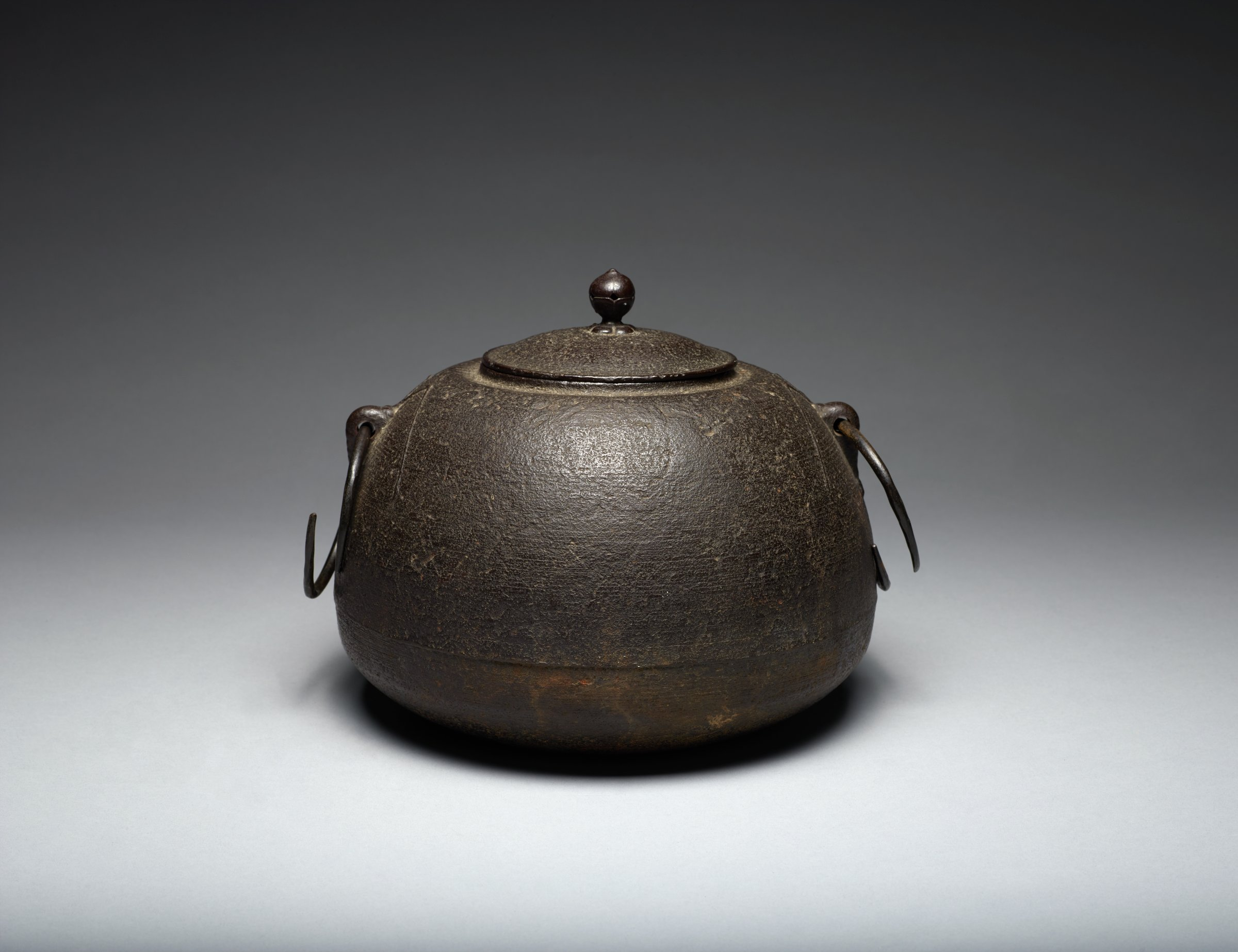 Kama Iron Kettle with Shrimp Handle Motifs and lotus bud finial on cover. Removable rings. Makers mark is cast into the piece.