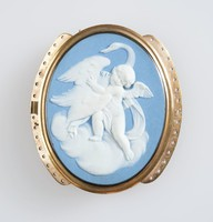 Oval blue jasper cameo with white relief scene of Cupid with swan, set in pinchbeck brass as buckle