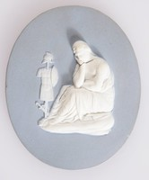 Oval gray-blue jasper plaque with white relief scene of A Conquered Province, with figure of mourning woman in front of suit of armor on pole, in ormolu frame