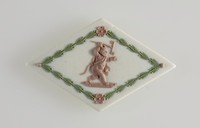 """Diamond-shaped tri-colored jasper (white, sage green, and lilac) cameo with lilac relief """"demon baby"""" and green leaf garland"""
