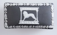 Black jasper match box with cover with white relief decoration, with serrated strike surface on inside of cover, commemorating British Empire Exhibition at Wembley 1924, with lion on cover