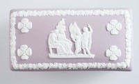 Lilac and white jasperware rectangular box with cover with various classical scenes to lid and sides. On cover is the scene of Icarus and Daedalus, to the sides are scenes of cupids in various poses.