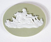 Oval sage green jasper medallion with white relief scene of woman on back of horse/seahorse in waves