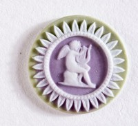 Tiny round tri-color jasper (sage green, lilac, and white) cameo with seated cupid holding lyre