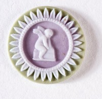 Tiny round tri-color jasper (sage green, lilac, and white) cameo with cupid seated