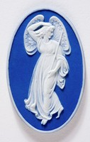 Oval dark blue jasper cameo with white relief of a Zephyr with polished edges