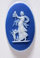 Oval dark blue jasper cameo with white relief woman with putti depicting Night and Day, also known as Venus and Cupid, or Night shedding Poppies, and Ceres and Triptolemus. Original model is attributed to John Bacon Senior 1777-1780