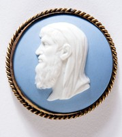 Round blue jasper medallion with white relief profile portrait of Theophrastus facing left, set in brass mount