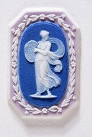 Octagonal tri-color jasper (lilac, dark blue, and white) cameo with white relief of a Nymph Playing Cymbals