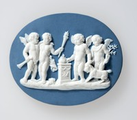 Oval blue jasper plaque with white relief scene of Sacrifice to Hymen. To the left of the altar are winged boys holding a trumpet and a torch, and to the right are two others leading a goat and carrying an olive-branch. this was modelled from an engraving by Bartolozzi c.1778