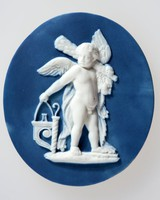 Oval dark blue jasper medallion with white relief of Cupid with the club of Hercules