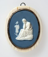 Oval dark blue jasper plaque with white relief scene of A Conquered Province, with figure of mourning woman in front of suit of armor on pole, set in ivory and metal frame
