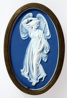 Oval dark blue jasper medallion with white relief figure of a Zephyr, set in chased brass frame possibly to be inset into furniture.