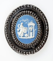 Oval blue jasper cameo with white relief decoration, set in cut steel as a buckle. the cut steel is multi faceted to imitate gemstones and is probably produced by Matthew Boulton, the jasperware shows the sacrifice to cupid.