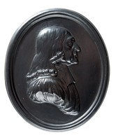 Oval black basalt medallion with relief profile portrait of Wesley (1703-1790) facing right, Founder of English methodism; the second son of Samuel Wesley, rector of Epworth. Educated at Charterhouse and Christ Church, Oxford. He showed great promise as a student, and developed a strong religious fervour after reading Law's Serious Call. He formed an association with other students of the college who held similar views, in their devotions and from the punctiliousness of the members demeanour, they became to be called 'methodists' by the wits of the university. Among the circle, apart from Wesley, was George Whitfield who was to acquire almost equal celebrity at the time. Wesley went to the American colony of Virginia and preached among the Indians. In 1738 he returned to London and began to preach, drawing large crowds. He then went to Bristol to become a field preacher in successiopn to Whitfield. He would usually travel 4,500 miles a year or a total of 225,000 miles in his lifetime delivering sermons from 2 to 4 hours long.