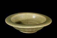 Miniature dish of Longchuan type, with celadon glaze and chocolate base, ribbed on underside